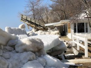 image of Ice shove lifting a deck and crushing a house