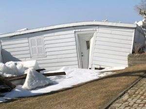 image of crushed boathouse on Arrowhead Beach