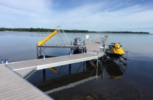 image of ShoreMaster RS 7 and RS4 curved dock with slide and jet ski lifts