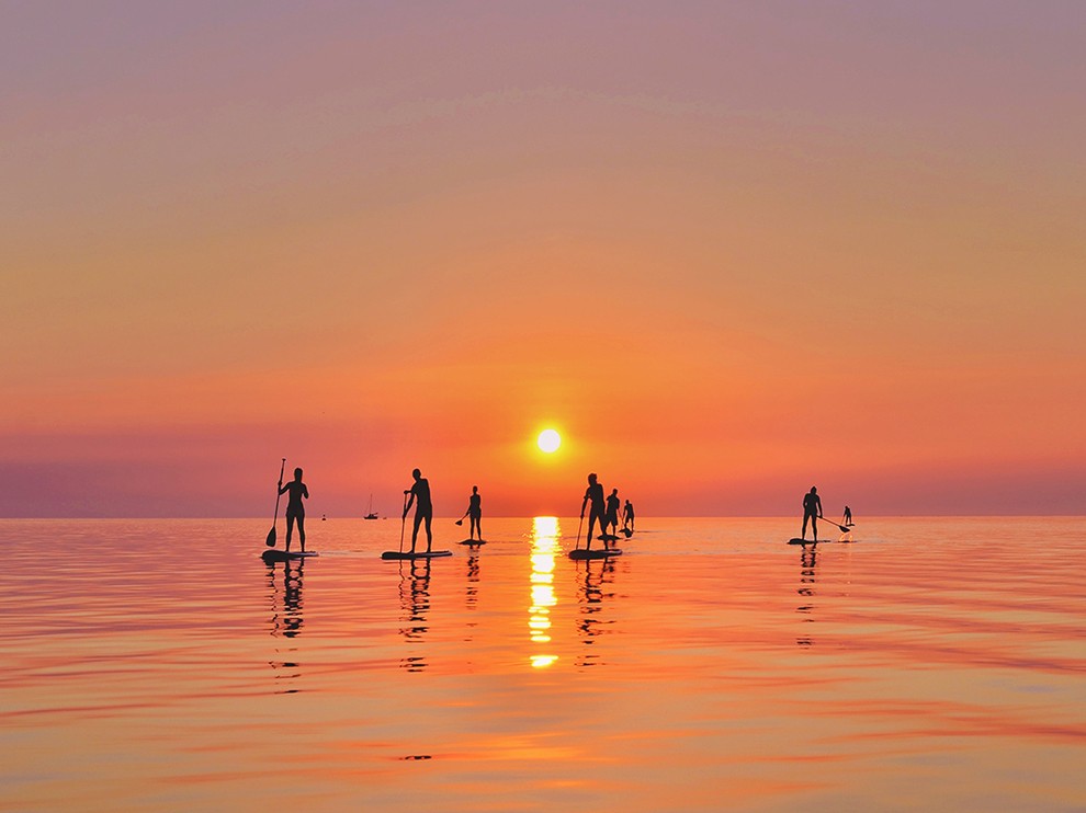 Paddleboards at sunset.